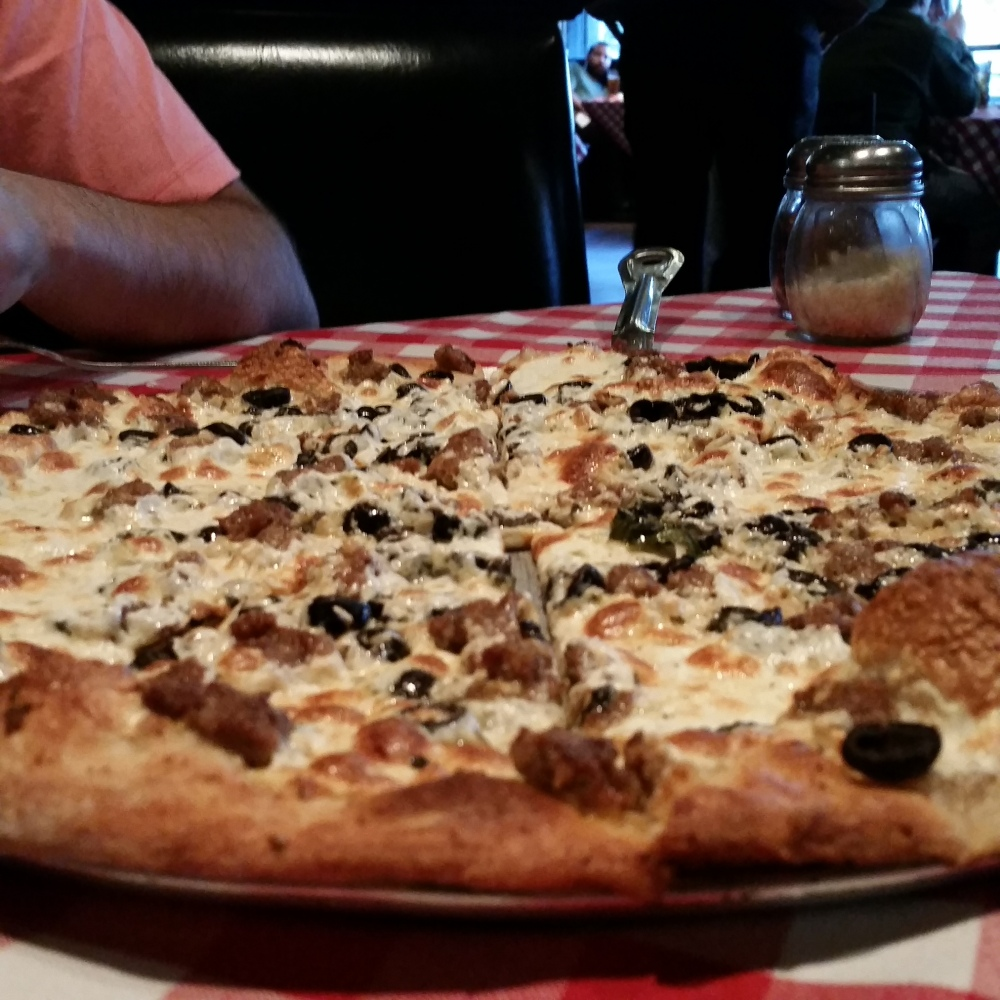 White Pizza with Sausage and Black Olives